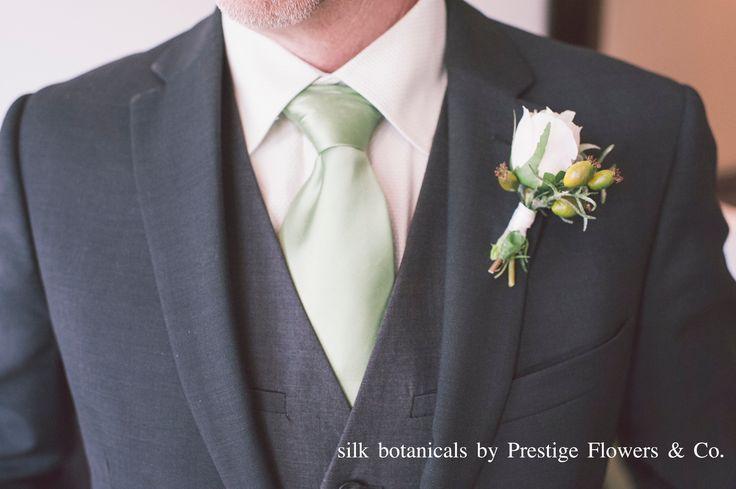 Silk botanicals: debonair boutonniere by Prestige Flowers & Co.
