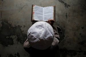 A Muslim boy learns to read the Qur'an at a madrassa, or religious school on the outskirts of Agartala, India