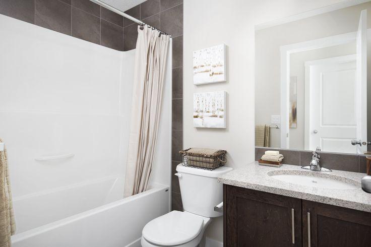 Main bath with light granite counters and dark wood cabinets #bath #bathroom