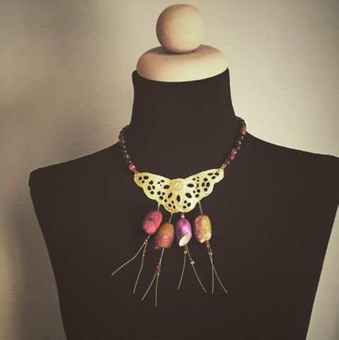 Handmade necklace with gold plated butterfly, semiprecious stones of tiger eye and silk cocoon..