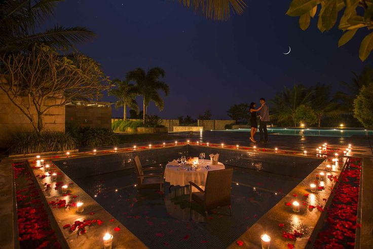 Exclusive Romantic Dinner Setup In The Pool Overlooking