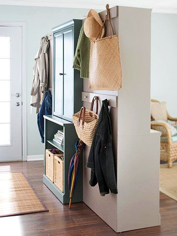 Mudroom - Divide and Conquer:  If your entry and living room are one and the same, divide the space with easy-to-assemble cabinetry. Here, there's room for hanging coats and storing gear on one side and attractive display and storage space on the other.