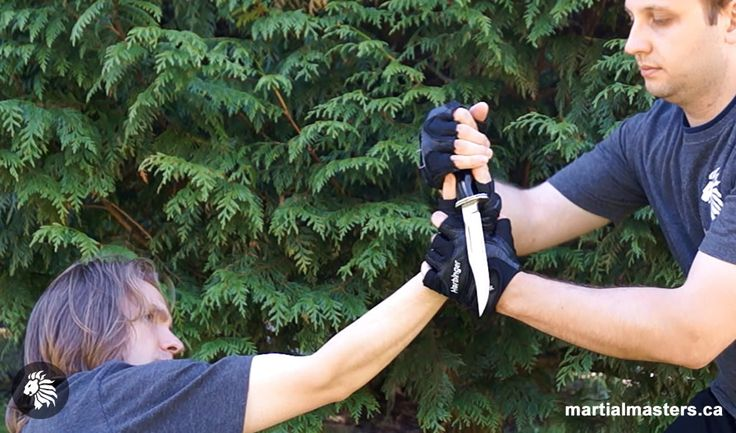 Combat knife disarm, with full wrist control via locked up elbow joint.