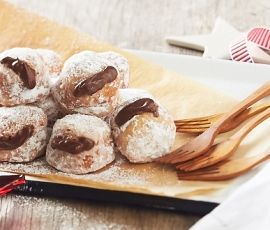 Milk Chocolate Bombilini's: Perfect pillows filled with oozing chocolate. http://www.bakers-corner.com.au/recipes/desserts/milk-chocolate-bombilinis/
