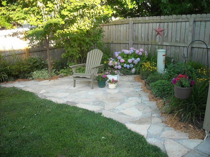 This DIY flagstone-paved oasis is a beautiful quiet corner out of  neighbors' sight.