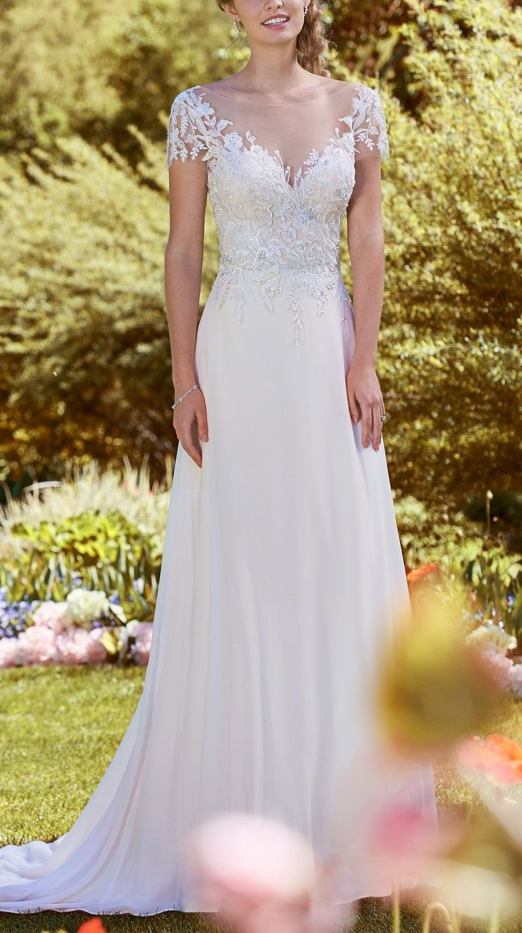 Rebecca Ingram - MERCY, Beaded lace motifs and Swarovski crystals adorn the bodice of this romantic sheath, completing the illusion short-sleeves, illusion V- over sweetheart neckline, and illusion V-back. An Arlo Chiffon skirt completes the soft elegance of this wedding dress.
