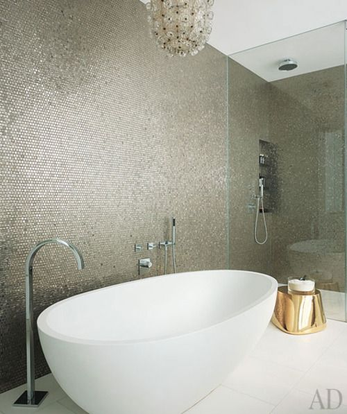 entire wall of penny tiles in metallic finish.