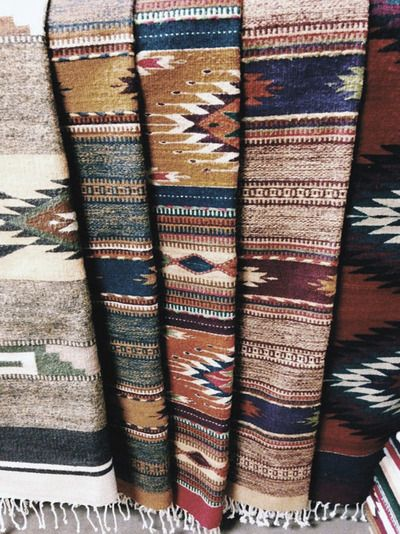 Woven rugs in natural tones.