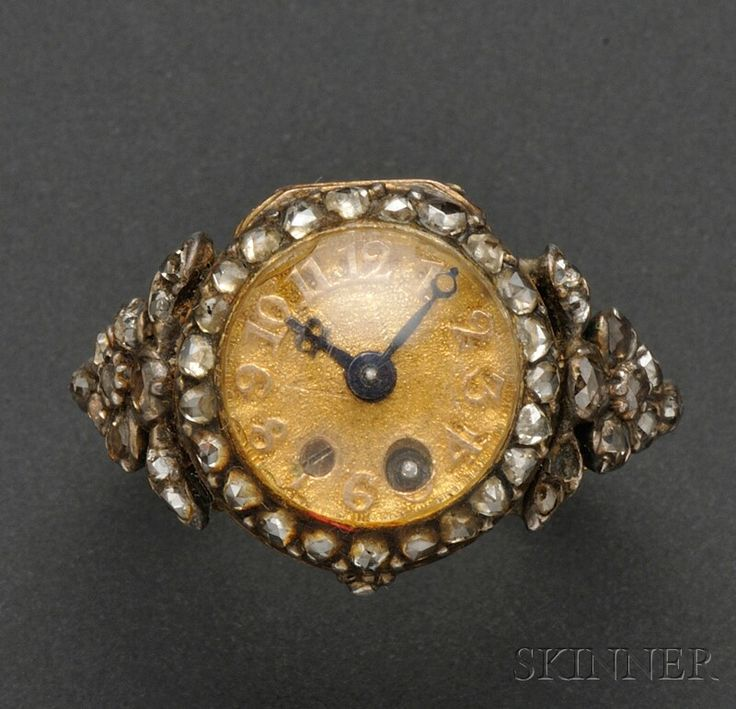 Whoa.  So cool.  Rare Antique Miniature Ring Watch, Pierre Morand, late 18th century, the gold dial with raised Arabic numeral indicators on matted ground, cylinder movement key-wind and key-set, rose-cut diamond bezel and shoulders, the back engraved with crossed quiver and arrows, 13 mm, signed on the dial rim.