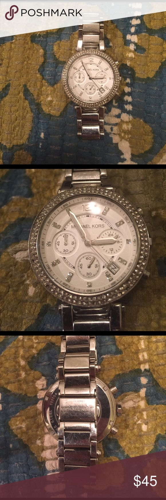 Michael Kors Silver Watch Michael Kors Silver Watch. 6 of the little diamonds are missing but are not hugely noticeable or can be fixed. The battery is dead so would need a new battery. Price reflects all of this. Michael Kors Accessories Watches