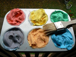 Food colouring in shaving cream - paint in the bathtub and wash it all away when done. No mess!