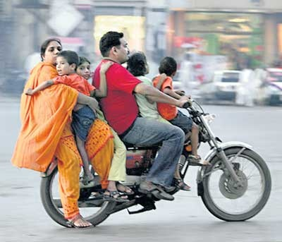 A typical sight on the streets of Pakistan, how many more on a bike is possible?