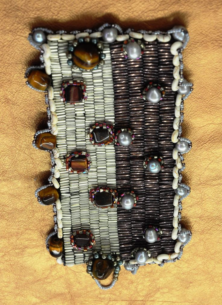 Couture bracelet with Natural sea pearls, Tiger eye stones, Genuine Crocodile Leather interior in a beautiful peyote stitch (11 hours to make)