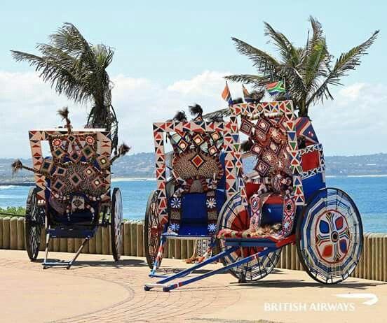 Durban SOUTH AFRICA ..........RIKSHAS ( man drawn cartage )