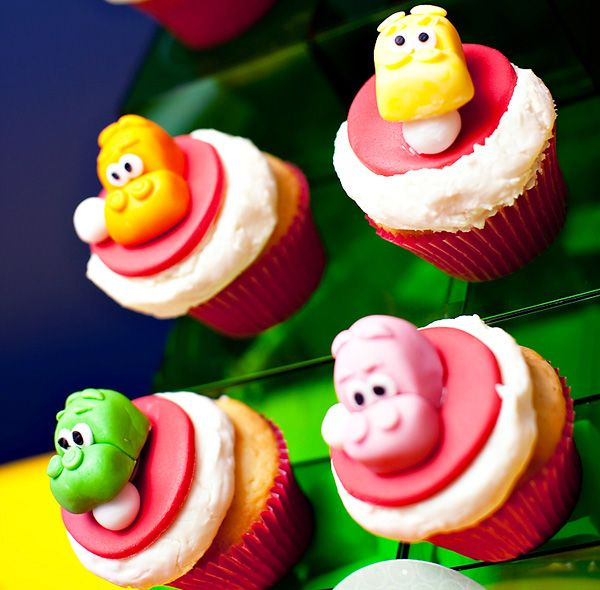 hungry, hungry hippos cupcakes. this was my FAVORITE game when i was little. my dad still complains about how much i cheated while playing it (i would swipe my arm across the board to shove all the marbles into my hippo's mouth... very discreet)
