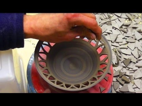 Carving / piercing a flower design into a clay pottery bowl thrown on the wheel. Using a sharpened tool made from a hack saw blade cuts are made to leave hol...