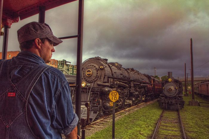 5. This scene at the Virginia Museum of Transportation in Roanoke shows an engineer looking out over the rail yard from the caboose of his train.