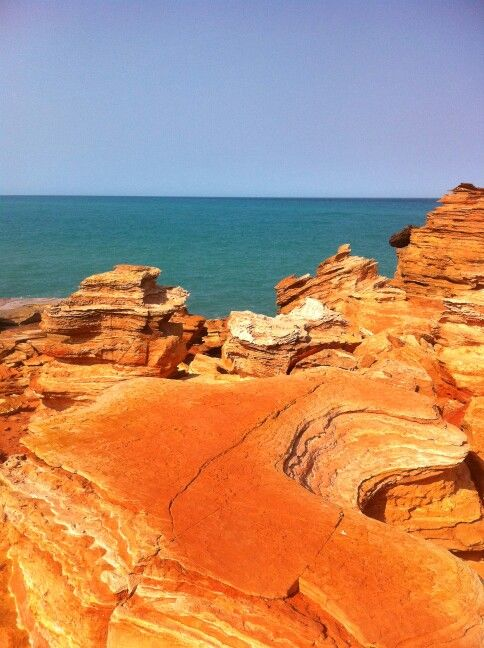 The magnificent red rocks of Broomes Gantheaume Point! The first bus of the day stops out there and then you can walk back along beach and finish with Breakfast at Cable Beach Club Resort (Or eat your own on cable beach)! | See Something New - seesomethingnew.com.au