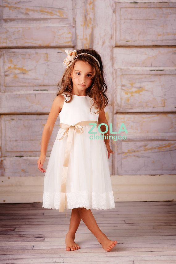 this is one very chic and pretty lace dress! featuring gorgeous ivory bridal satin bodice with very pretty lace embellished at hem, she is sure