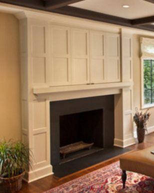 Conceal TV over fireplace with cabinitry