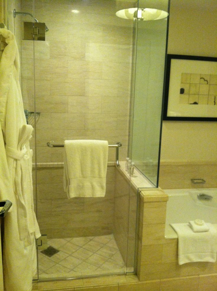 view of the glass enclosed walk in showers in the renovated suites at four hotels in las vegasthe vegas nevadafour seasons hotelbathroom ideas