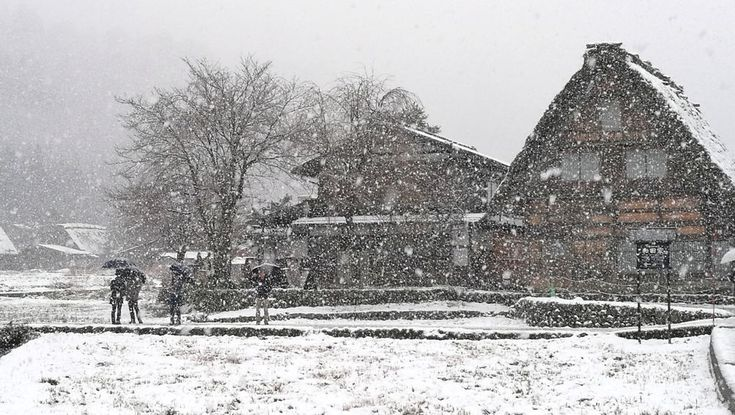 """Shirakawa-go, Japan, is caught in a heavy snowfall.(Photo: JACK Photographer/Shutterstock) Shirakawa-go, Japan The historic village of Shirakawa-go is a mountain town known for its steep forests and traditional farmhouse building style known as gasshō-zukuri, with thatched roofs built to withstand heaps of snow. With a name that translates into """"White River Village,"""" according to Smithsonian, the town gets a remarkable 415 inches (10.5 meters) of snow each year.  A UNESCO World Heritage Site"""