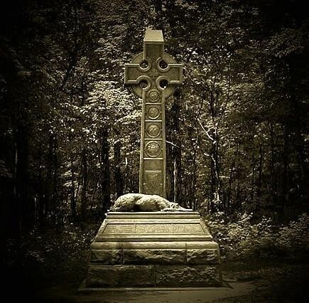 The Irish Memorial at Gettysburg, Pennsylvania.  This is dedicated to the 600 members of the Irish Brigade that fought at Gettysburg in the Civil War, and were either wounded or killed.  At the feet of the Celtic Cross lies one of their mascots, a faithful Irish Wolfhound.