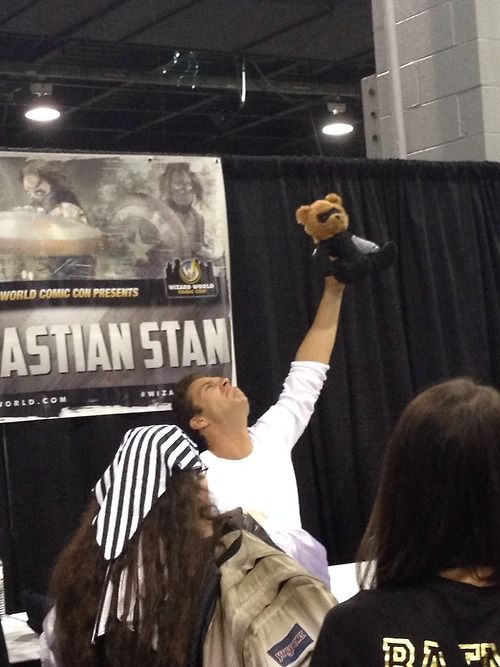 Sebastian Stan's reaction to a teddy bear dressed as the Winter Soldier. I want that bear. No, seriously. Give me that bear.