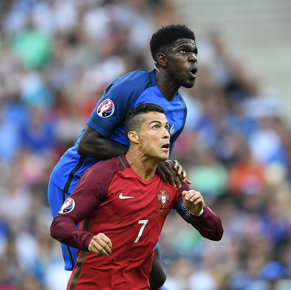 #EURO2016 Cristiano Ronaldo of Portugal in action against Samuel Umtiti of France during the Euro 2016 final match between Portugal and France at Stade de...