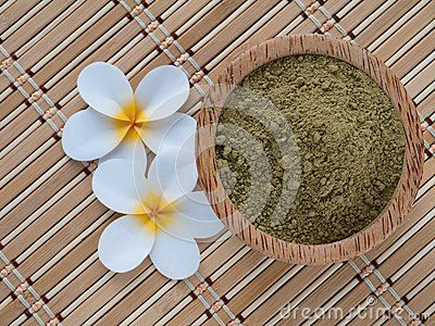 Henna powder in coconut bowl on the bamboo mat