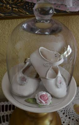girl baby shower ideas  boy baby shoes would look SWEET in a cloche with a tiny toy with them. ;-)