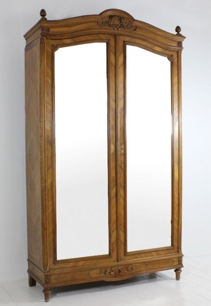 This beautiful French 2 door Armoire is made from Wallnut and has lovely carved features as well as Acorns on the top of the Armoire. Behind the 2 generous mirrored doors is lots of shelving space as well as 2 handy drawers in the bottom of the cabinet. All original with its original hardware and almost an antique (dates 1920's.) #Armoire #Armoires