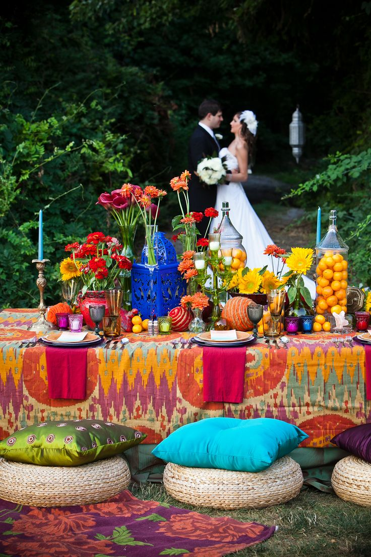 This Morrocan-themed event was brought to life with seat cushions, lanterns, and an intricate tablecloth in saturated shades.