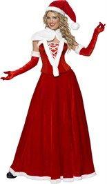 Elegante lange kerstvrouwen jurk met muts, korset, cape en handschoenen.