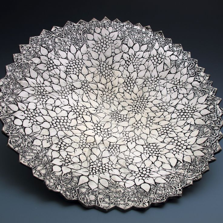 Stunningly handsome hand-built stoneware bowlin a layered floral pattern includes wall cleat for wall mounting. 19 inches in diameter, 4 inches rim to foot