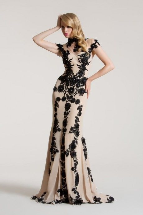 Long Nude/Black Amarisso New York dress with tulle illusion on the bust and lace details and a tale.