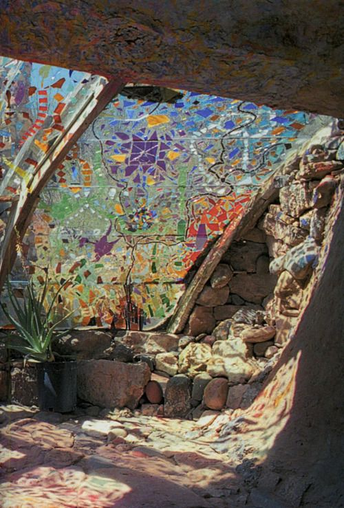 © 2003 Shelter Publications, Inc.    Amazing greenhouse room built of old auto windshields, with stained glass siliconed to inside of glass.