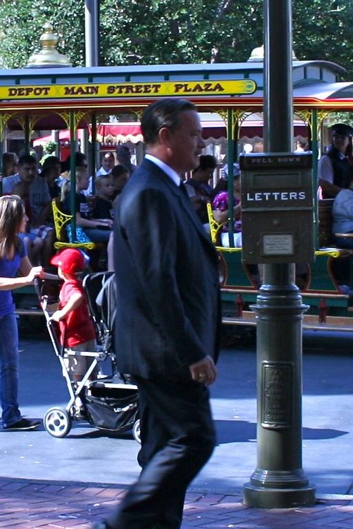 Tom Hanks as Walt Disney while filming Saving Mr. Banks in Disneyland. Love it! Just walking down Main St like Walt used to :)