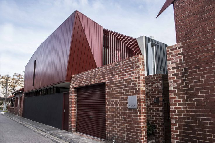 O'Grady Street features our Interlocking wall cladding panel system in Colorbond Steel's Manor Red. #metalcladding #metalcladdingsystems #melbourne #architecture #design #homes #houses #inspo #red #architectural #architecturalproducts #steel #facade #panels #walls #design #architecturalcladding #system #steel #Colorbond #wallpanel #wallcladding #sheetmetal