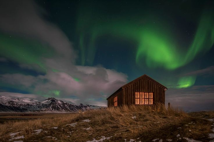 The aurora borealis dancing over an abandoned house, Photograph by Dany Eid