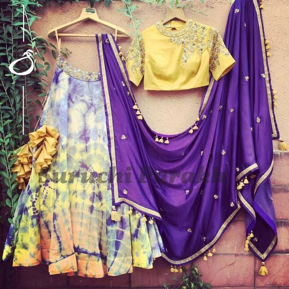 A new week with Suruchi gorgeous new collection. Exploring tie and dye fabrics and we are so awestruck by the outcome. Gorgeous bright and colourful tie and dye skirt with embellished waist paired with equally mesmering mustard handwork crop top and cotton satin zardosi work dupatta.  05 June 2017