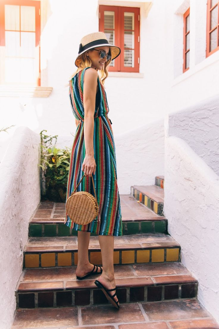 Little Blonde Book A Fashion Blog by Taylor Morgan: Rainbow Crochet. Colourfull striped croched midi dress+black flat sandals+wicker round basket bag+straw hat+sunglasses. Summer Casual Outfit 2017