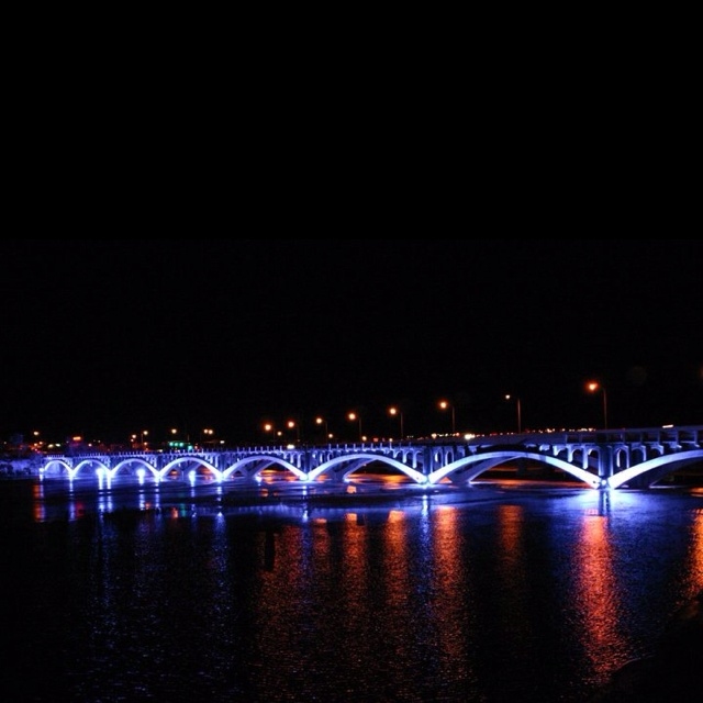 Blue lights on historical Bridge over the Missouri River in Great Falls, Montana...