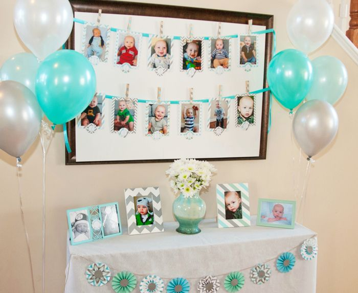 Cute First-Birthday Party Display (love this for a display of all the pictures Steve & I have taken as reveals and maternity pictures taken later-- very easy but super cute display, balloons and all!)