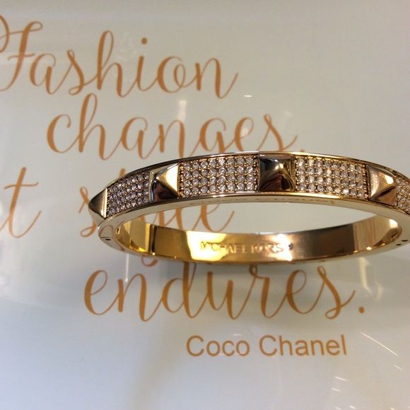 Michael Kors Pavé Studded Gold Bracelet MK studded bangle styled in gold-tone played steel, featuring glass crystal pavé embellishments hinge fastening closure. NWT - excellent condition. Comes with dust bag Michael Kors Jewelry Bracelets