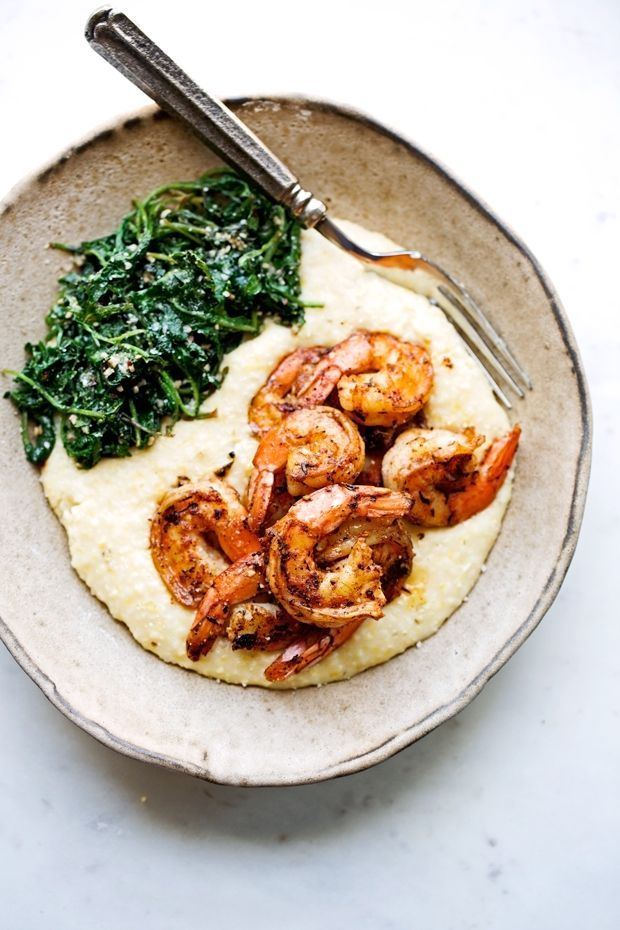 Cajun-style shrimp and Grits with Sautéed Garlic Kale-- a lighter take than the traditional Louisiana style recipe.