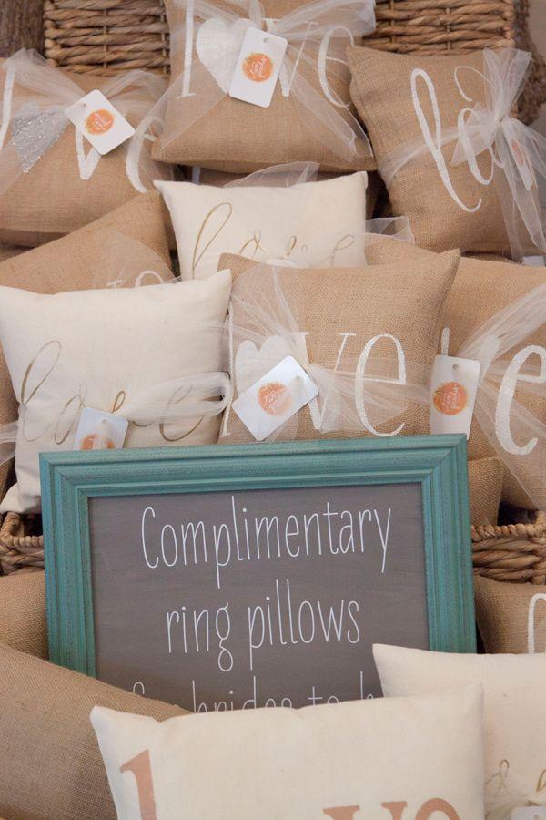 burlap ring pillows, photo by Nicole Caudle Photography http://ruffledblog.com/notwedding-charlotte #weddingideas #ringpillows