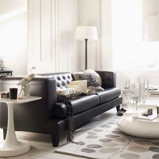 Dark sofa surrounded by white