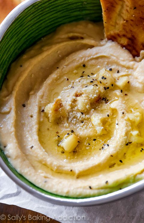 Roasted Garlic Parmesan Hummus Recipe - smooth as silk and served up with homemade pita chips