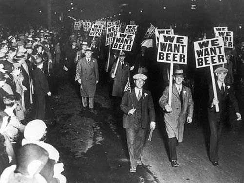 """ Men demonstration against alcohol prohibition in the 1920s. """